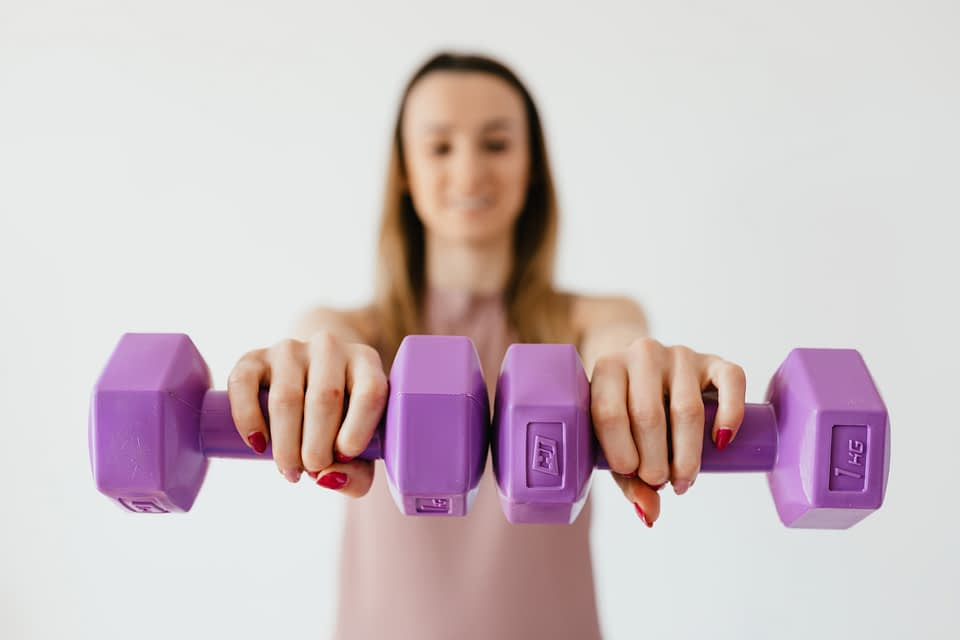 woman with a pair of weights