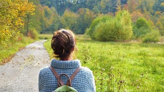 Woman walking on a trail
